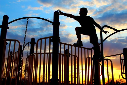 park blue boy sunset playing canada color colour silhouette yellow kids fun climb winnipeg canadian manitoba climbing story stories playstructure stnorbert littlestories picswithsoul noelrichot
