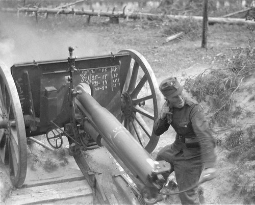 Finnish soldiers fire a captured Soviet  76-mm cannon 76 K02-30 in area of Repola Ontrosenvaara 7th September 1941