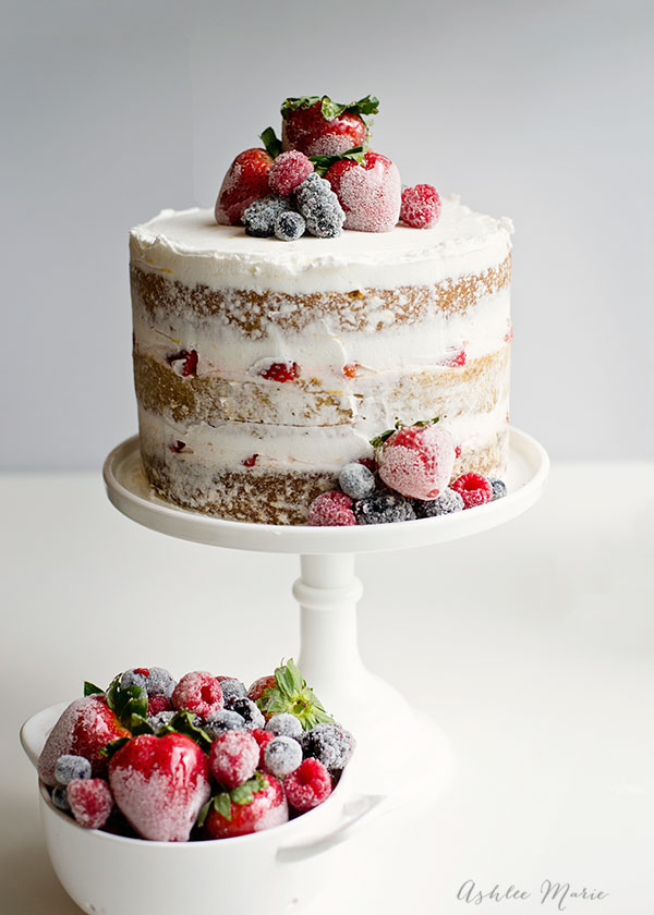 A quick and easy layered summer cake with candied strawberries and sugared berries, sweet and refreshing!