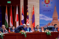 U.S. Secretary of State John Kerry speaks with Assistant Secretary of State for East Asian and Pacific Affairs Daniel Russel at the National Convention Center in Vientiane, Laos, on July 26, 2016, during a meeting of the ASEAN Regional Forum amid the annual meeting of the Association of Southeast Asian Nations (ASEAN). [State Department Photo/ Public Domain]