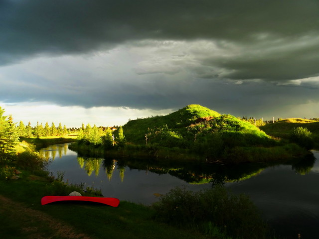 Last night's approaching storm and red canoe (+2)
