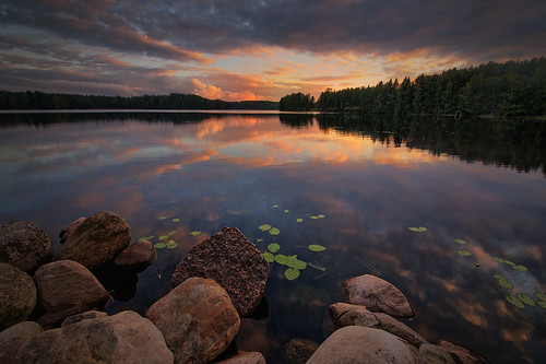 trees sunset summer sky lake reflection beach nature water beautiful silhouette clouds finland landscape outdoors evening countryside rocks waterlily violet lakeshore serene finnish dramaticsky tranquil waterscape mäntyharju milamai