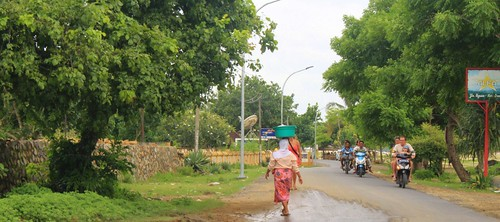 Woman walking down the streets of Kuta, Lombok