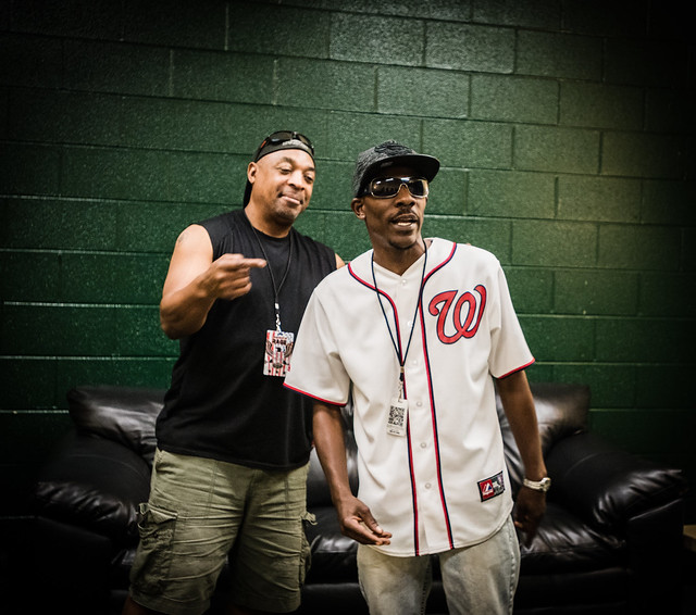 A photo of Chuck D pointing to Ronald Dudley.
