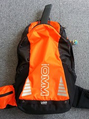 yellow(0.0), personal flotation device(0.0), outerwear(0.0), bag(1.0), orange(1.0), backpack(1.0),