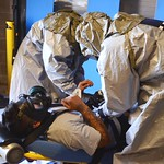 A Pueblo Chemical Agent-Destruction Pilot Plant ordnance technician is strapped down to a gurney by medical staff during a practice drill in the Enhanced Reconfiguration Building. The drill includes taking him to the medical center to be evaluated and treated.