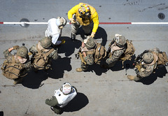 Senior Chief participates in an air assault exercise with Marines on the flight USS Bonhomme Richard.