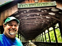 Visiting Ohio's second longest #coveredbridge called 'Bridge of Dreams' over the Mohican River. #biketrails #mohicanbiketrail #bridges #travel #backroads #visitohio