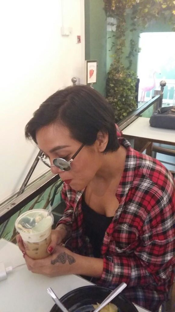 Cinta Ramlan enjoying a cup of coffee with the face of her biggest fan printed on top