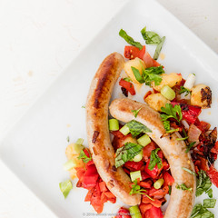 Bratwurst with spring onion, shallot, apricot, swe…