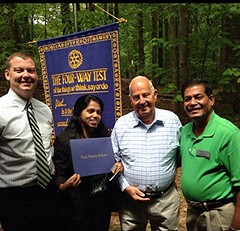 L-R: Jay Williams, President of Rotary Club of North Raleigh, Stella Ray of the Total Life Center, club member Burt Anderson and James Ray the husband of Stella. Twice a year the RCNR holds its weekly meeting as an outdoor picnic. The weather was perfect!  Annually, Ms. Ray welcomes our club members to the Total Life Center a few weeks before Xmas. The Rotary Club donates holiday gifts to all the men and women who daily attend the Center.