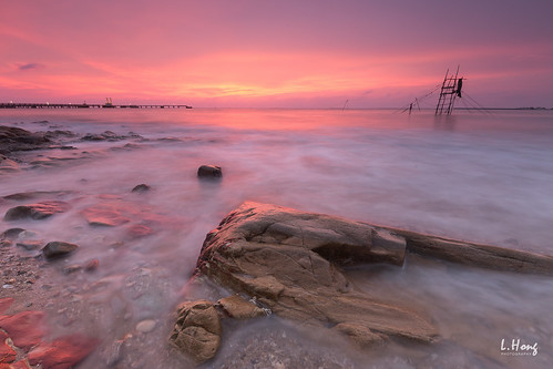 pink sunset sea clouds coast rocks long exposure
