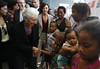 Managing Director Christine Lagarde meets local residents at Complexo do Alemao with Brazil's Social Development Minister Tereza Campello