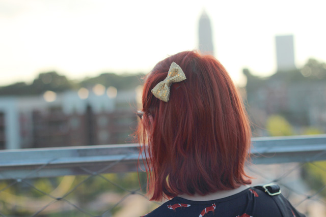 Bright Red Hair and a Gold Sequined Hair Bow
