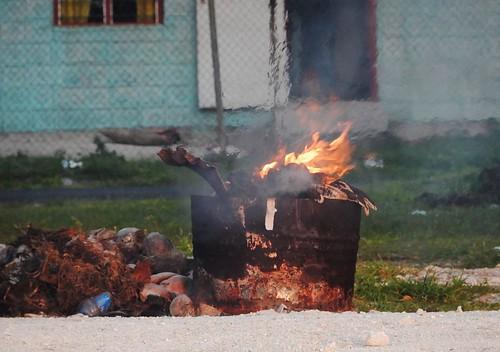 tuvalu funafuti bin fire flames beach