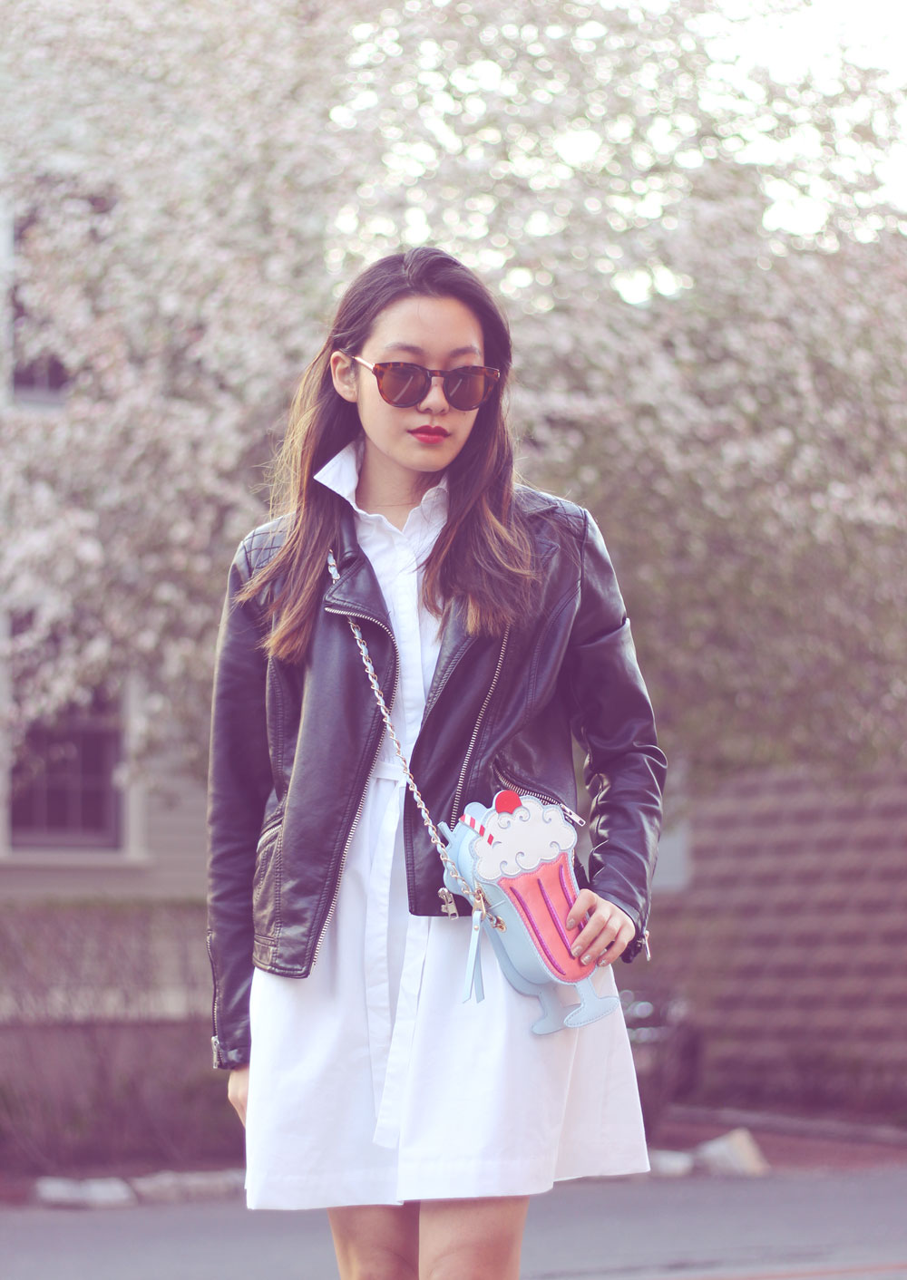 Black leather jacket with white shirt dress and novelty bag