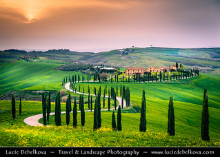 Italy - Tuscany - Toscana - Curvy road of Val d'Orcia at Sunset