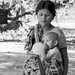 Burmese woman with her little child, Chin village, Mrauk u, Burma