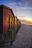 Muizenberg Beach Huts Light up with the Sunrise
