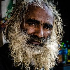 dreadlocks(0.0), face(1.0), facial hair(1.0), hairstyle(1.0), head(1.0), hair(1.0), close-up(1.0), portrait(1.0), beard(1.0),