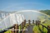 LIVINGSTONE, ZAMBIA -  Walking pathway across fro Victoria Falls Waterfall with rainbow