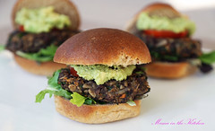 Veggie Loaded BBQ Black Bean Burger with Sweet Potato, Mushrooms and Kale in a homemade bun with Greens, Tomatoes, Smashed Avocadoes and BBQ sauce.