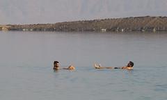 Two men floating in the Dead Sea, Ein Bokek, Israel