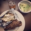 Finally watching the last 2 episodes of Mad Men! Decided to 1960's our dinner: grilled New York steak, baked potatoes w/all the fixings, Caesar salad & Manhattans.