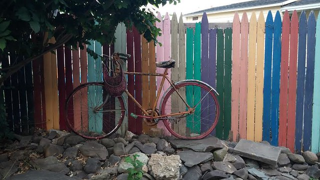 BIKE ON THE ROCKS WITH FENCE
