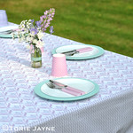 Outdoor pom pom trim tablecloth tutorial