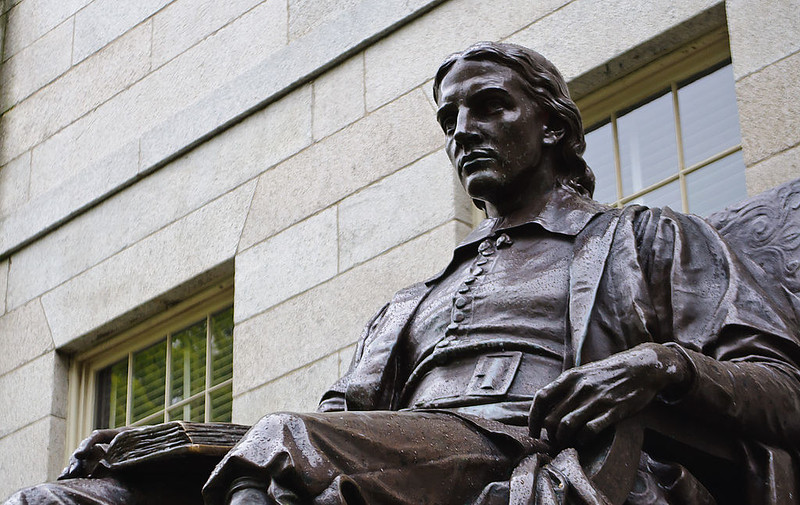 "An ""idealized"" representation of John Harvard in the college yard of Harvard University"