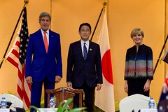 U.S. Secretary of State John Kerry stands with Japan Foreign Minister Fumio Kishida and Australian Foreign Minister Julie Bishop at the Lao Plaza Hotel in Vientiane, Laos, on July 25, 2016, before a trilateral meeting on the sidelines the annual meeting of the Association of Southeast Asian Nations (ASEAN). [State Department Photo/ Public Domain]