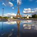 Bad puddle mirror on Eiffel Tower in Paris by Loïc Lagarde