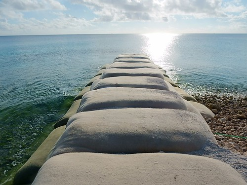 funafuti sandbags sunset coast glow horizon