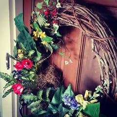Barbara's wreath hadn't been up 4 days before birds had built a nest.  They do this every year.