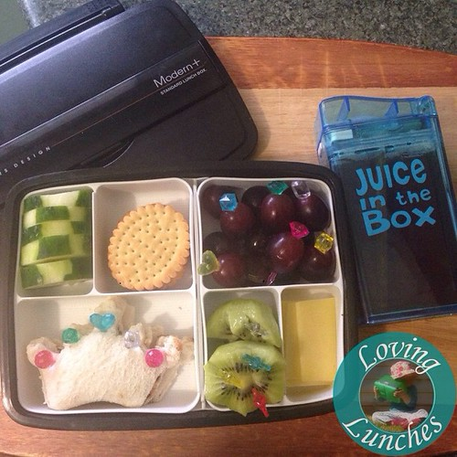 Loving tomorrow's Queen's Birthday inspired lunch… cucumber, biscuits, crown sandwich, grapes, kiwi fruit crowns, cheese and tea in our @boardwalkimports #JuiceInTheBox Cute food picks from @daisoaustraliaofficial Lunchbox from @little_bento