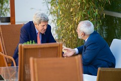 U.S. Secretary of State John Kerry sits with Iranian Foreign Minister Javad Zarif for a one-on-one chat before a broader meeting in Geneva, Switzerland, on May 30, 2015, at the outset of the latest round in the P5+1 negotiations about the future of Iran's nuclear program. [State Department Photo/ Public Domain]