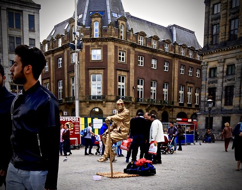 A golden floating guy in Dam Square, Amsterdam