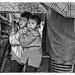 Two children share an umbrella in Cherrapunjee, the rainiest location of the planet. by stevebfotos